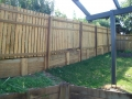Timber Fence construction on sleeper retaining wall