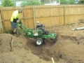 All Access Stump Grinding in action in a house footing in Brighton.(note the screw footings)